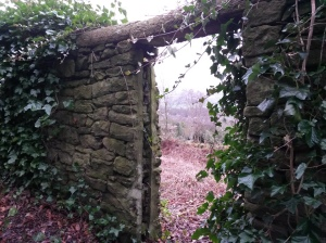 annedegruchy.co.uk image: stone doorway with view of woods