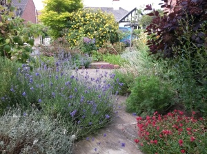 www.annedegruchy.co.uk image:  front garden full of flowers